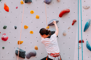 Image of a climber on a climbing wall