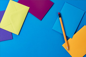 Image of colourful post it notes and a pencil